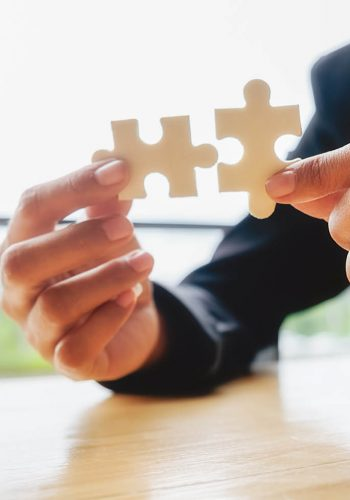Business woman hands connecting jigsaw puzzle. Business solutions, success and strategy concept. Businessman hand connecting jigsaw puzzle.